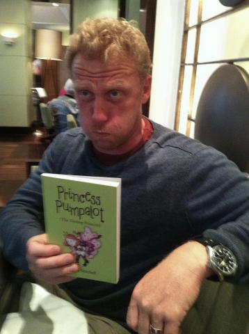 Kevin McKidd poses with the book